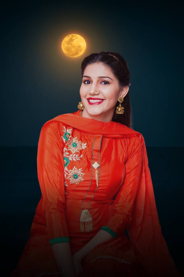 Sapna Choudhary's HD Photos in Orange Dress